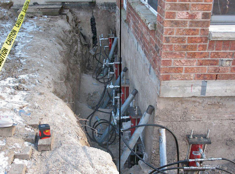 foundation push piers installed around a house with a foundation