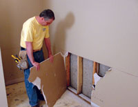 Remove the damaged drywall