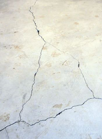 severely cracked, heaving slab floors in a home in Saint Helena Island