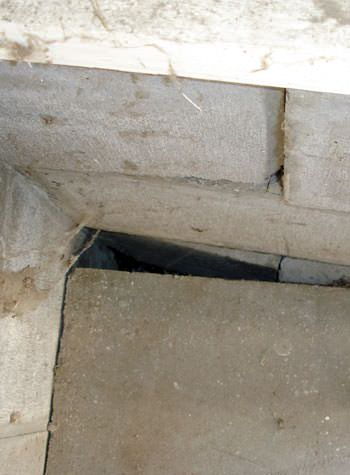 inward rotation of a foundation wall damaged by street creep in a garage in Bonaire