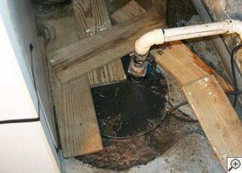 An ugly, clogged sump pump system in Warner Robins, Georgia and South Carolina