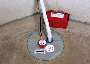 A sump pump system with a battery backup system installed in Lyons