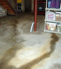 Flooding entering a basement through a floor crack in Rincon