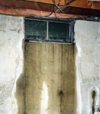Flooding through basement windows in a Metter home.