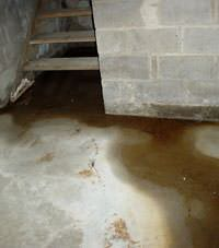 Flooding floor cracks by a hatchway door in