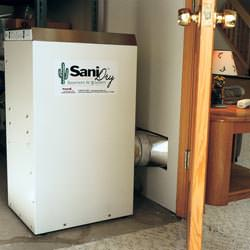 A basement dehumidifier with an ENERGY STAR® rating ducting dry air into a finished area of the basement  in Metter