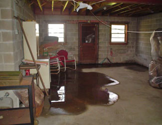 a flooded basement floor in a Bonaire home